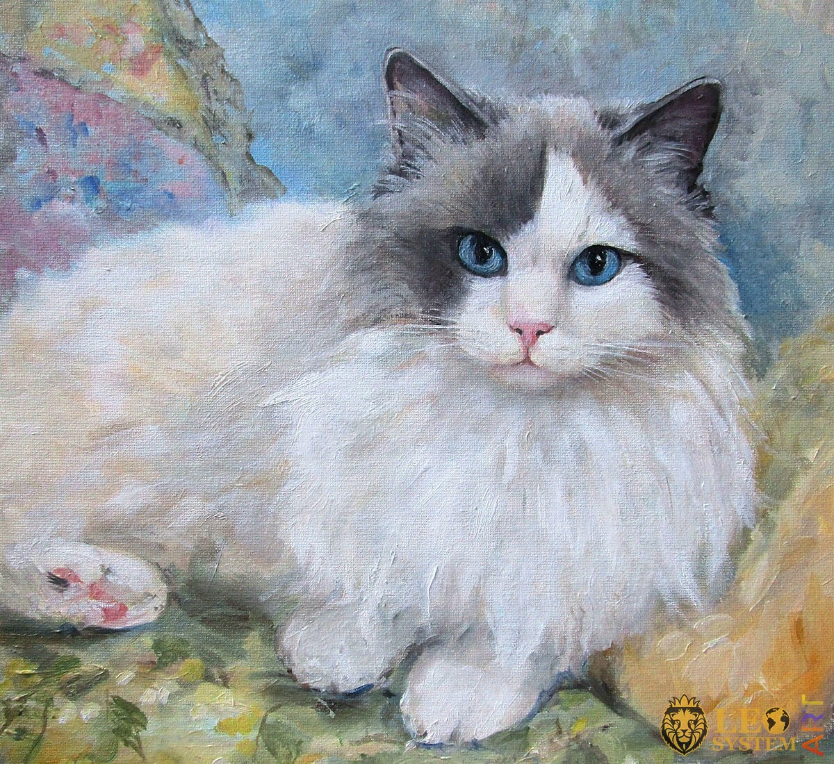 Beautiful cat with blue eyes looks attentively