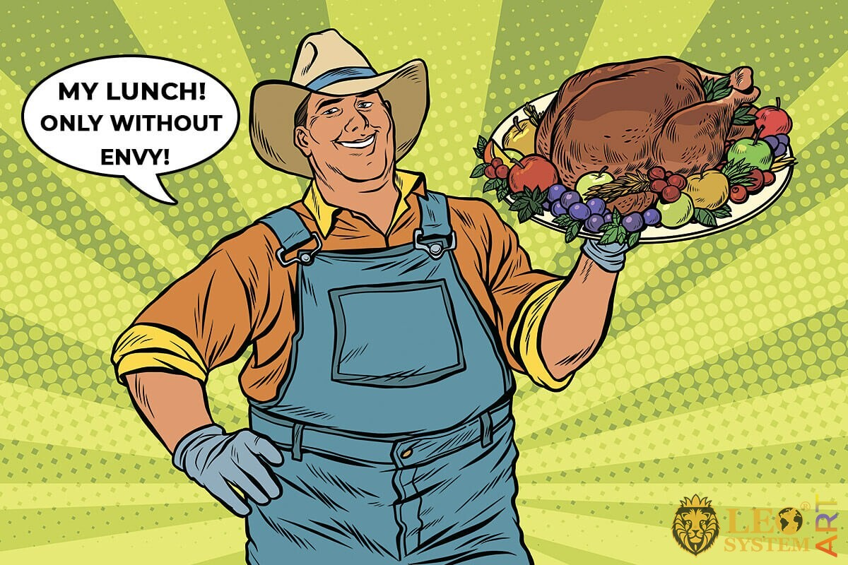 Cheerful man with roasted turkey on a tray