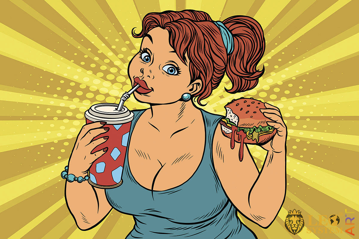 Picture of a woman with a glass of sparkling water and a burger in her hands