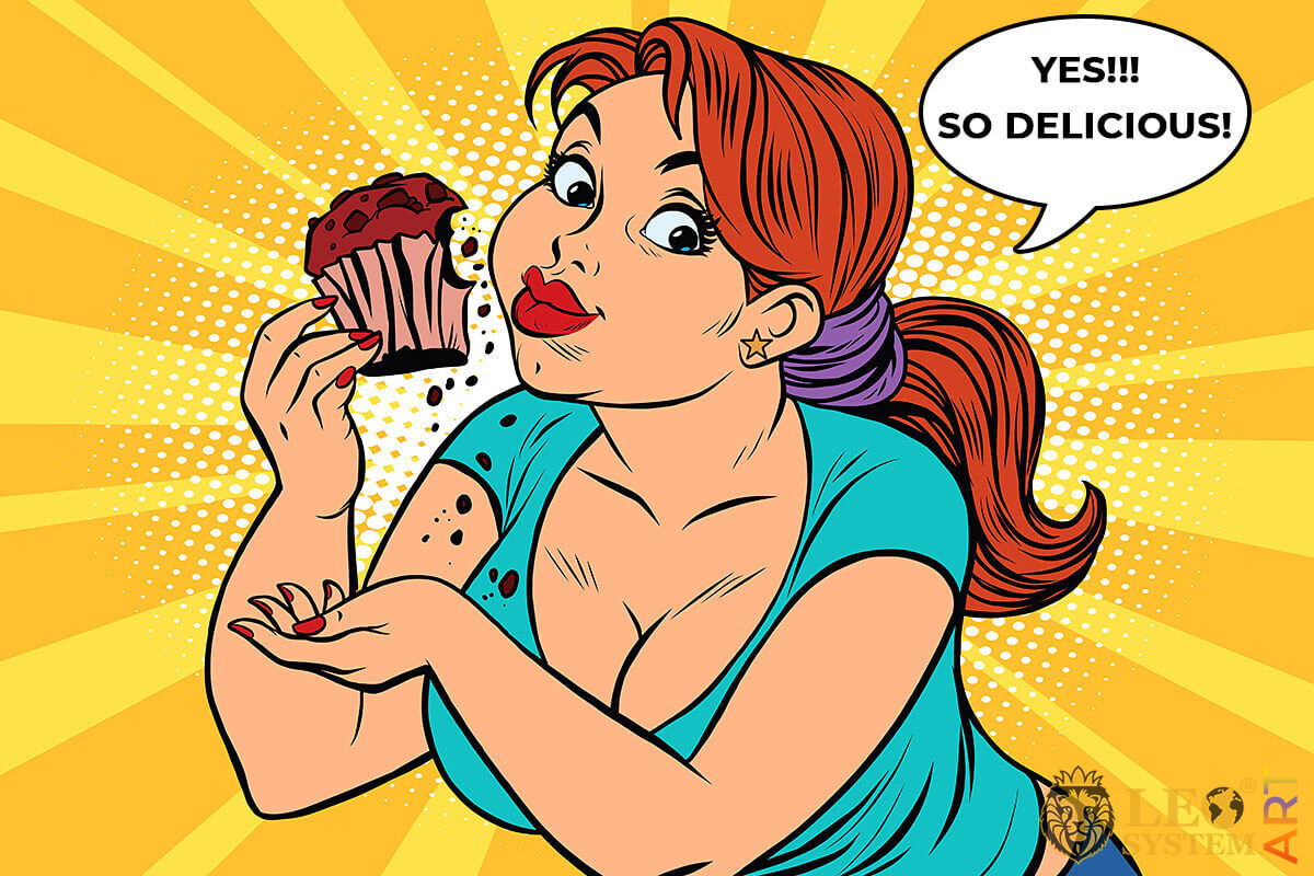 Curvy lady eating delicious cake