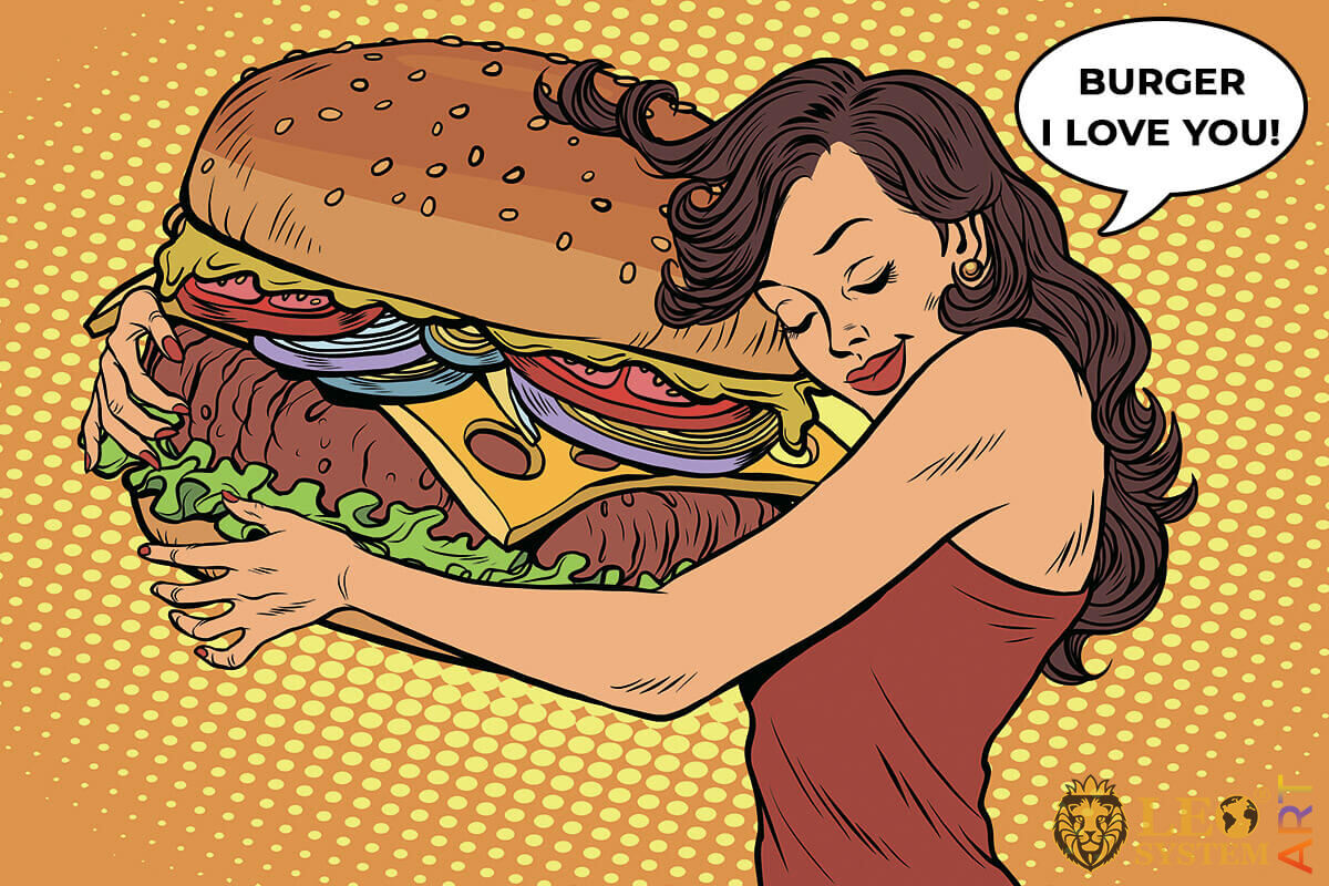 Pretty woman with huge burger in her hands