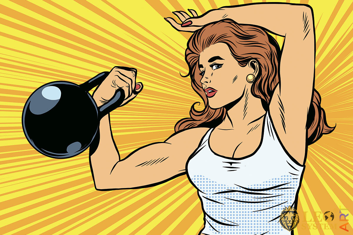 Strong athletic woman with a big kettlebell in her hand
