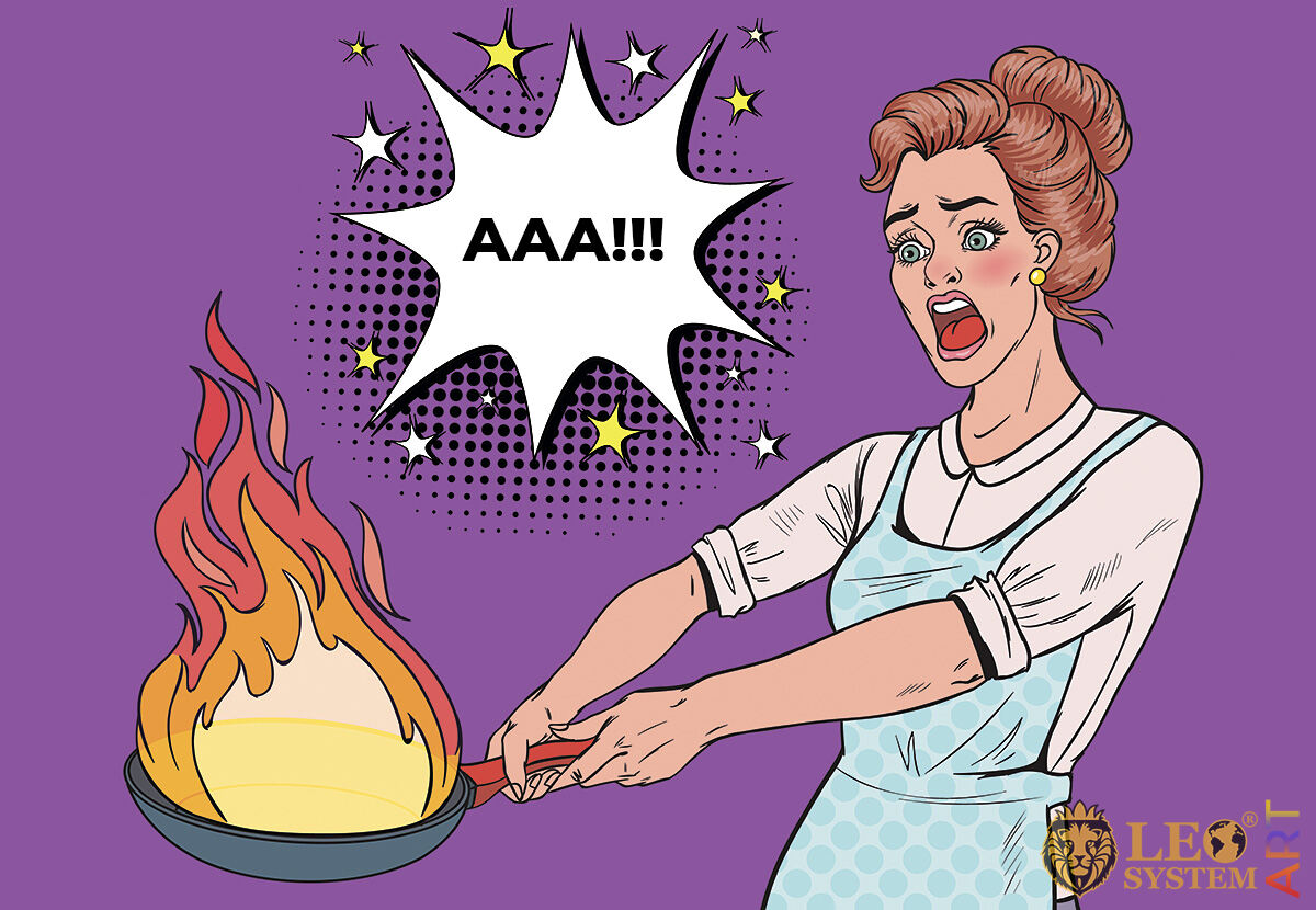 Picture of a screaming woman with a burning frying pan in her hands