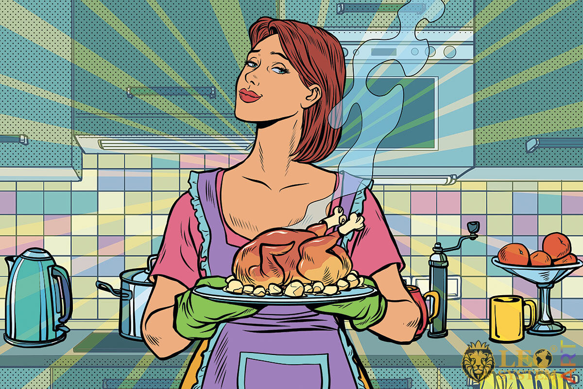 Picture of a cute housewife holding a deliciously cooked chicken