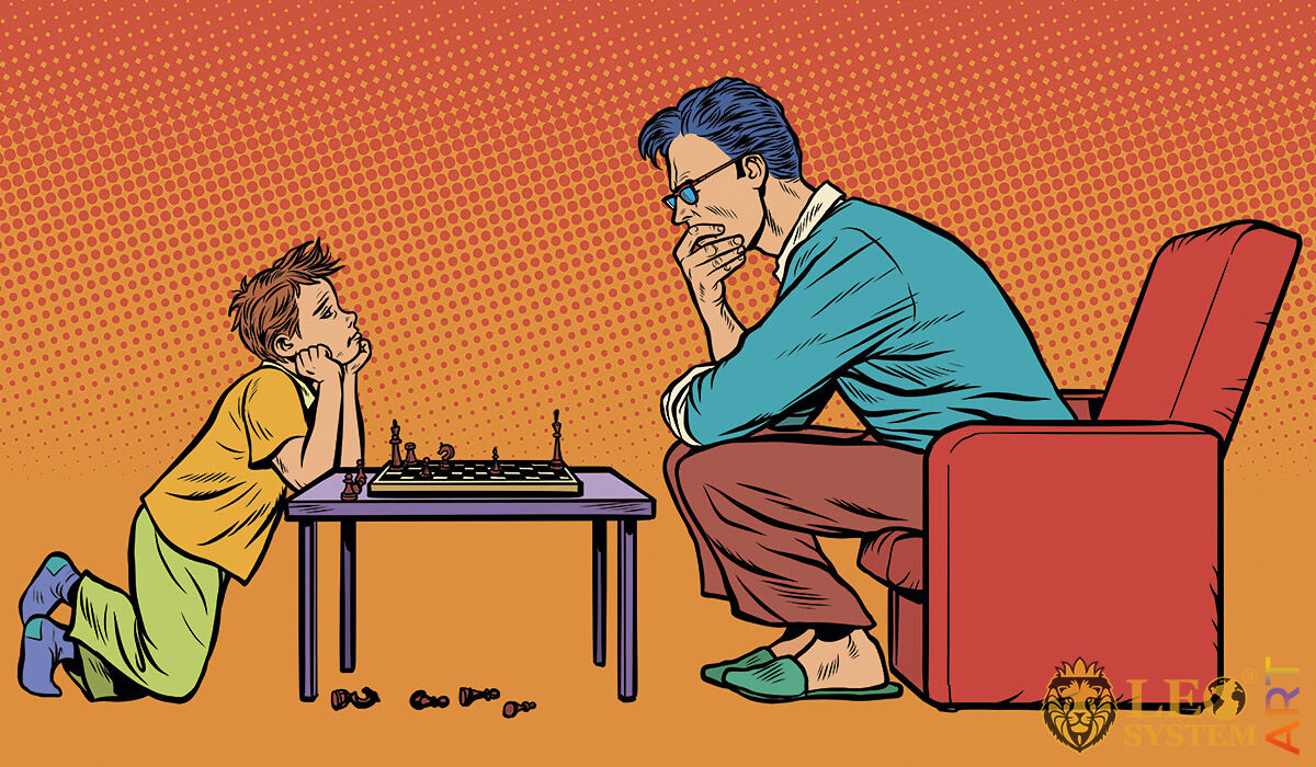 Picture of a father and his son playing chess