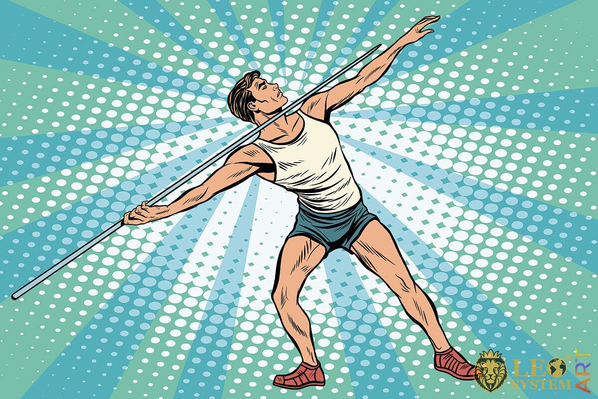 Sportive man throwing a spear