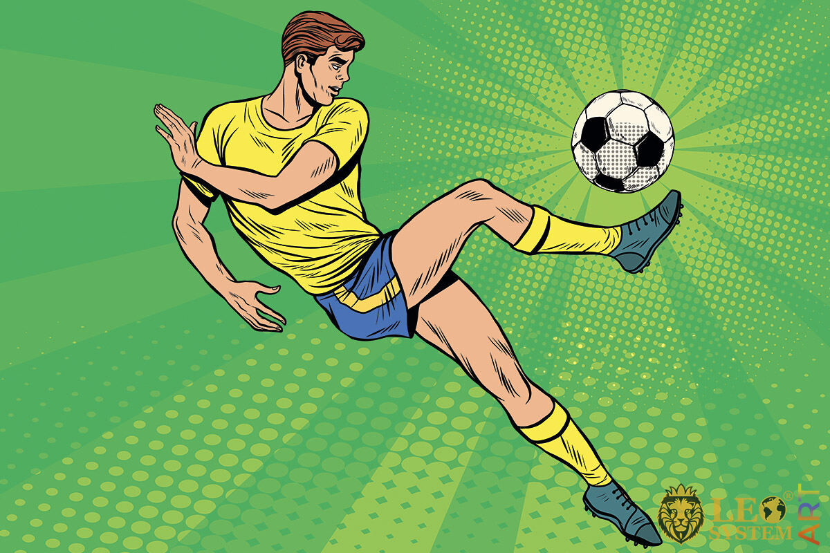 Picture of a dexterous football player kicking the ball