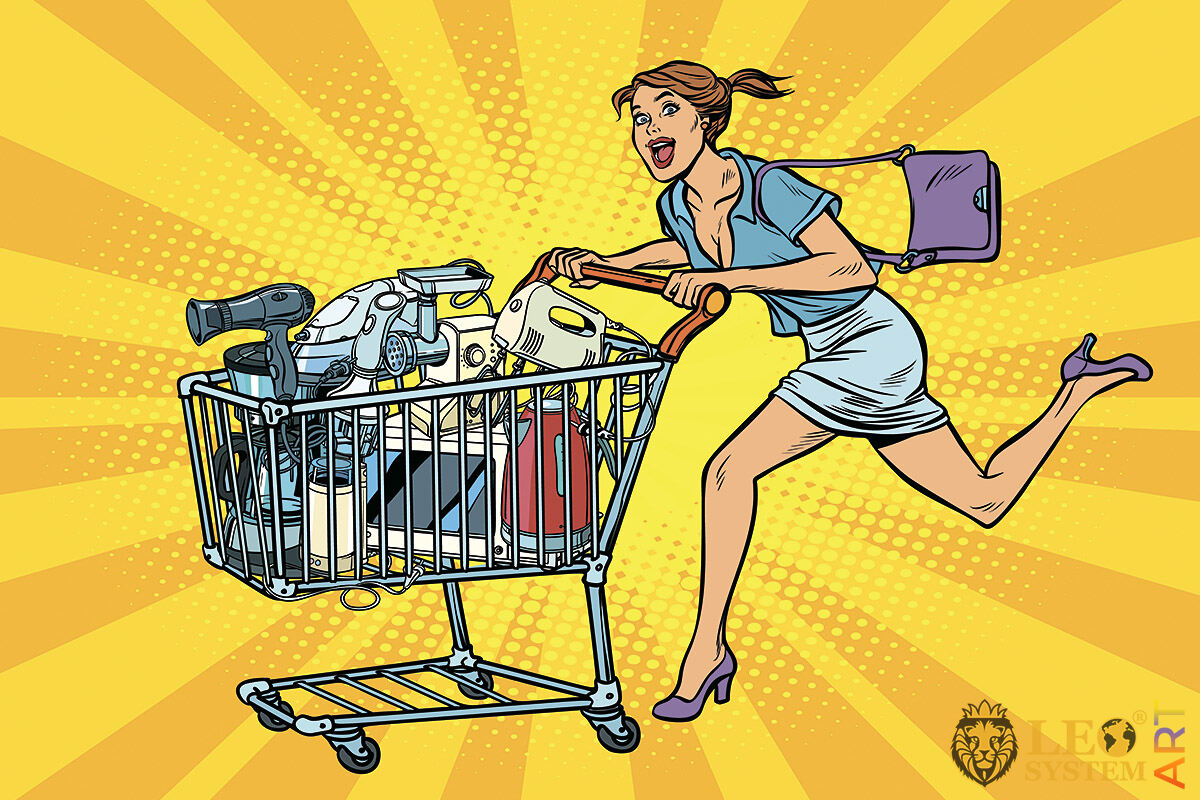 Picture of a woman running with a cart full of goods after shopping