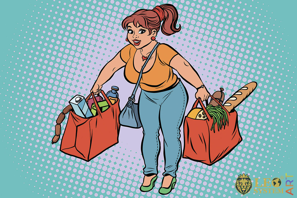 Picture of a tired woman with large bags of groceries in her hands