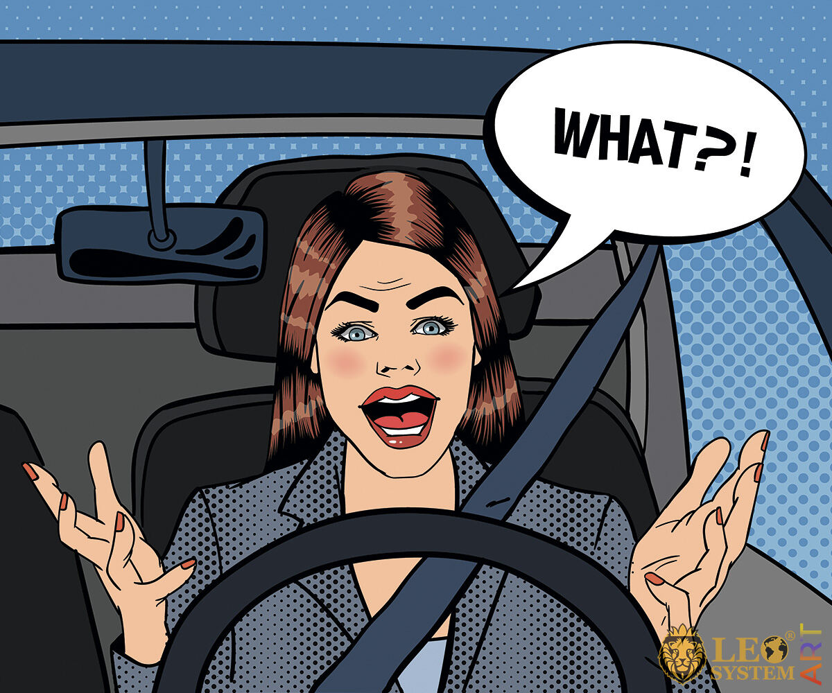 Picture of an amazed woman driving a car